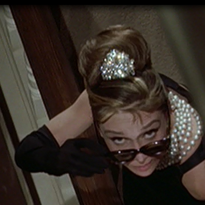 Audrey Hepburn, in the movie Breakfast at Tiffanys wears a rhinestone tiara in the  opening scene of the movie, 6 A.M. coming back from a party